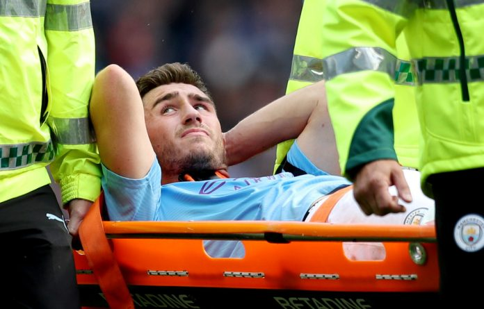 Manchester City's Aymeric Laporte is stretchered off after sustaining an injury.