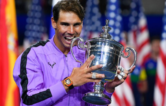 Rafael Nadal celebrates with the championship trophy after beating Daniil Medvedev of Russia in the men's singles final on day fourteen of the 2019 U.S. Open tennis tournament.