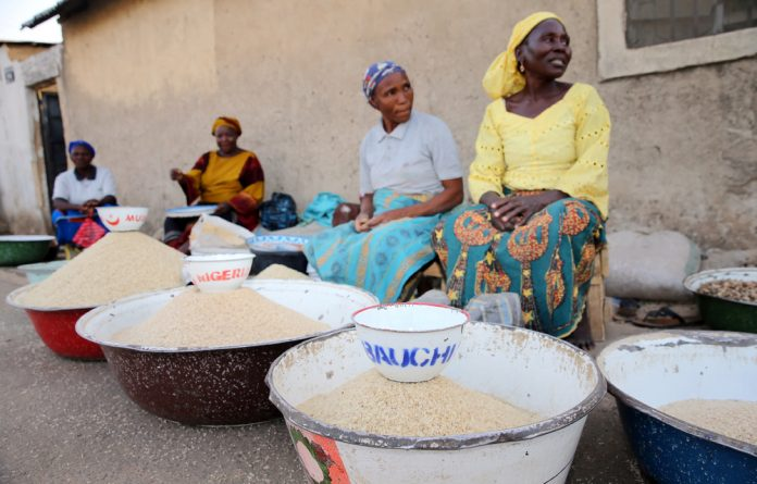Women selling rice are seen at a local market in Bauchi