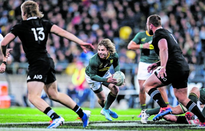 Fearless: Springbok scrumhalf Faf de Klerk in action against the All Blacks. This Bok team exudes similar confidence to the winning 2007 squad.
