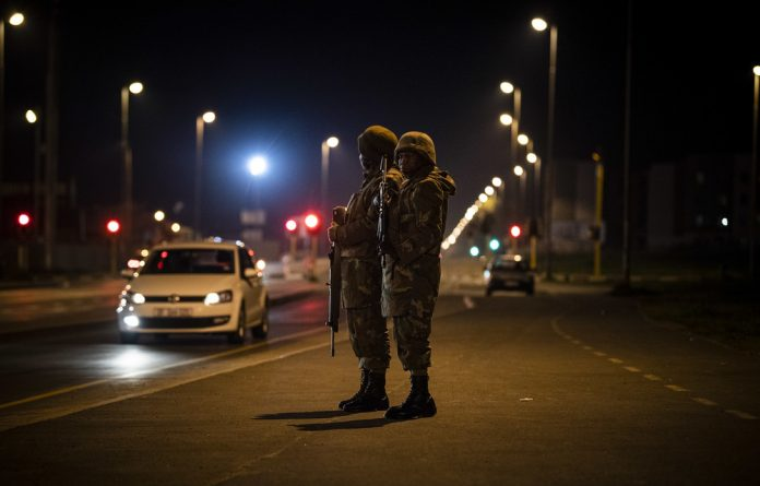 Gang up: The South African National Defence force will remain on duty in violent areas of the Cape until March.
