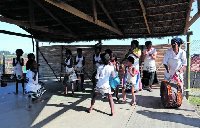 Youngsters perform a Xhosa local dance at the Ngxingxolo Cultural Village