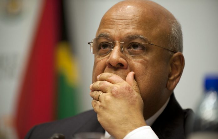"Public Enterprises Minister Pravin Gordhan has been accused by the Economic Freedom Fighters of being a member of a ""cabal""."