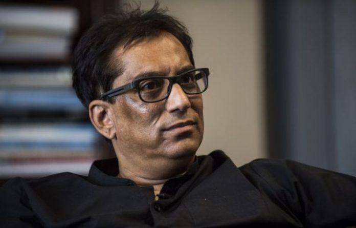 "Iqbal Survé claimed that Public Enterprises Minister Pravin Gordhan ""is using public resources to fight political battles."