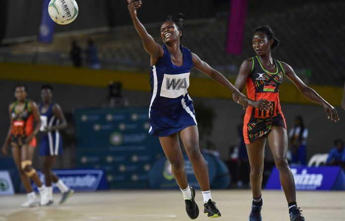 Lofty goals: Kenya's Deborah Khakula and Malawi's Grace Mwafulirwa. Four of the top eight teams at the recent Netball World Cup hailed from Africa