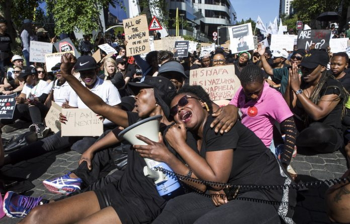 Enough: Women at a protest against gender-based violence at the JSE last month. Xenophobic sentiment and gender violence have become cemented in social consciousness