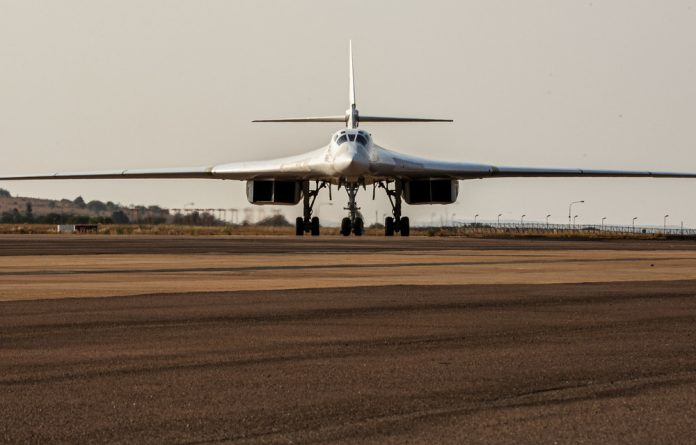 Menacing: This Russian Air Force Tupolev Tu-160 'Blackjack' is one of two supersonic bombers parked on the tarmac at the Waterkloof Air force Base.
