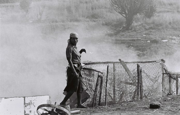 'No Defence … Only a Burnt Fence.' This photo was taken by Deseni Soobben during forced removals in Newlands