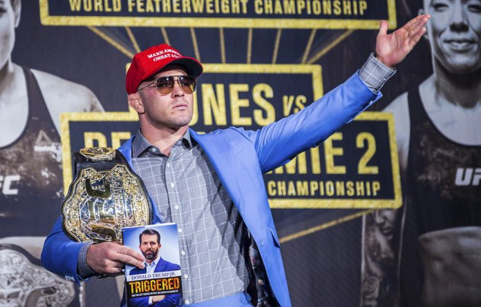 Dickhead: Crowds would love it if 'Nigerian Nightmare' Kamaru Usman beat the shtick out of Colby Covington.