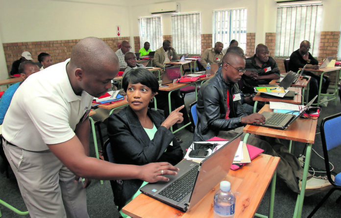 A group of teachers undergoing digital skills training in the DBE Teacher Center in Seshego