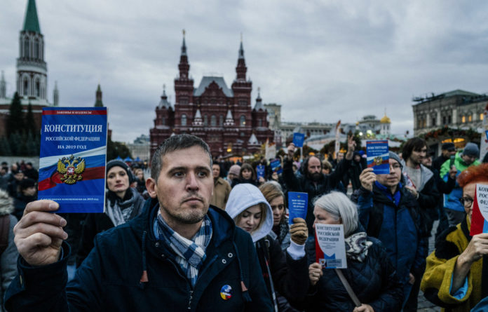 Resistance: Opposition supporters walk on Red Square to support Konstantin Kotov