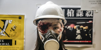 Chilling tribute: A protester wears an eye patch to honour another protester who was shot in the eye during a demonstration. Police in several countries have been criticised for using controversial ammunition.