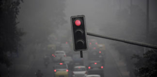Health hazard: Traffic during heavy fog in Delhi. Air pollution has damaged the lungs of half the city's children. Photo: Cathal McNaughton/Reuters