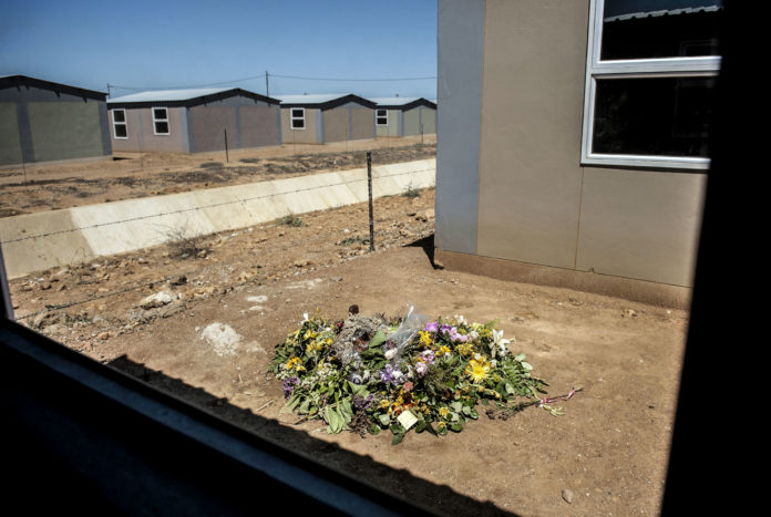 Flowers mark the place where Anene Booysen was raped and murdered in Bredasdorp in 2013