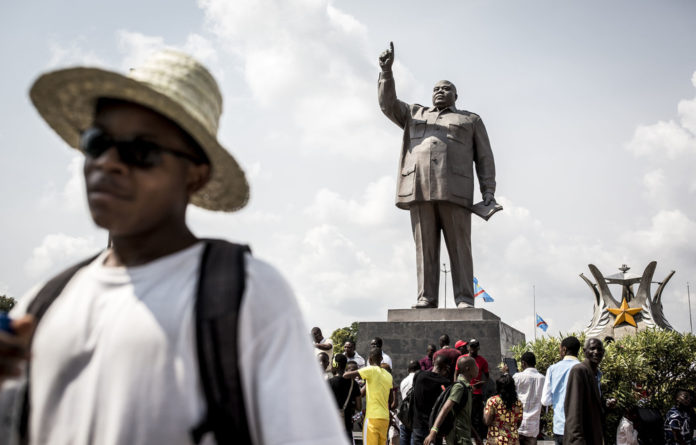 Dancing while we weep: A statue of former Democratic Republic of the Congo president Laurent-Désiré Kabila on the 18th anniversary of his assassination — January 16 2019 — in Kinshasa.