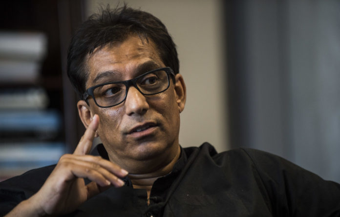Iqbal Survé's Sekunjalo Investment Holdings denies it owes the PIC more than R1-billion it used to acquire the media group.