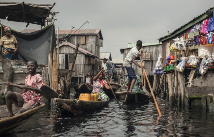 Vive la francaphonie! Residents navigate the waterways of Makoko. The area is home to about 100 000 French speakers.