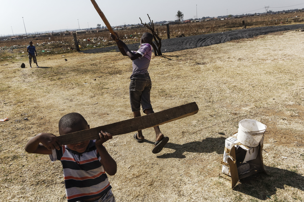 A photograph of children playing, taken from Tsepo Gumbi's series Re-Imagining Sharpeville