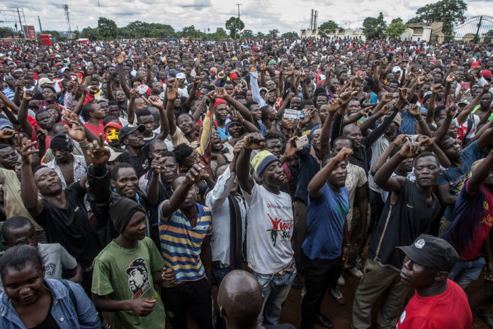Power to the people: Protesters at a rally in Lilongwe in January gathered to denounce alleged attempts to bribe judges overseeing a legal challenge to the re-election last year of Malawian President Peter Mutharika
