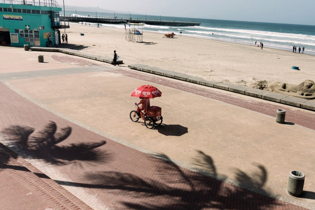 An ice cream vendor on a tricycle at the deserted north beach in Durban. (Rajesh Jantilal/AFP via Getty Images)